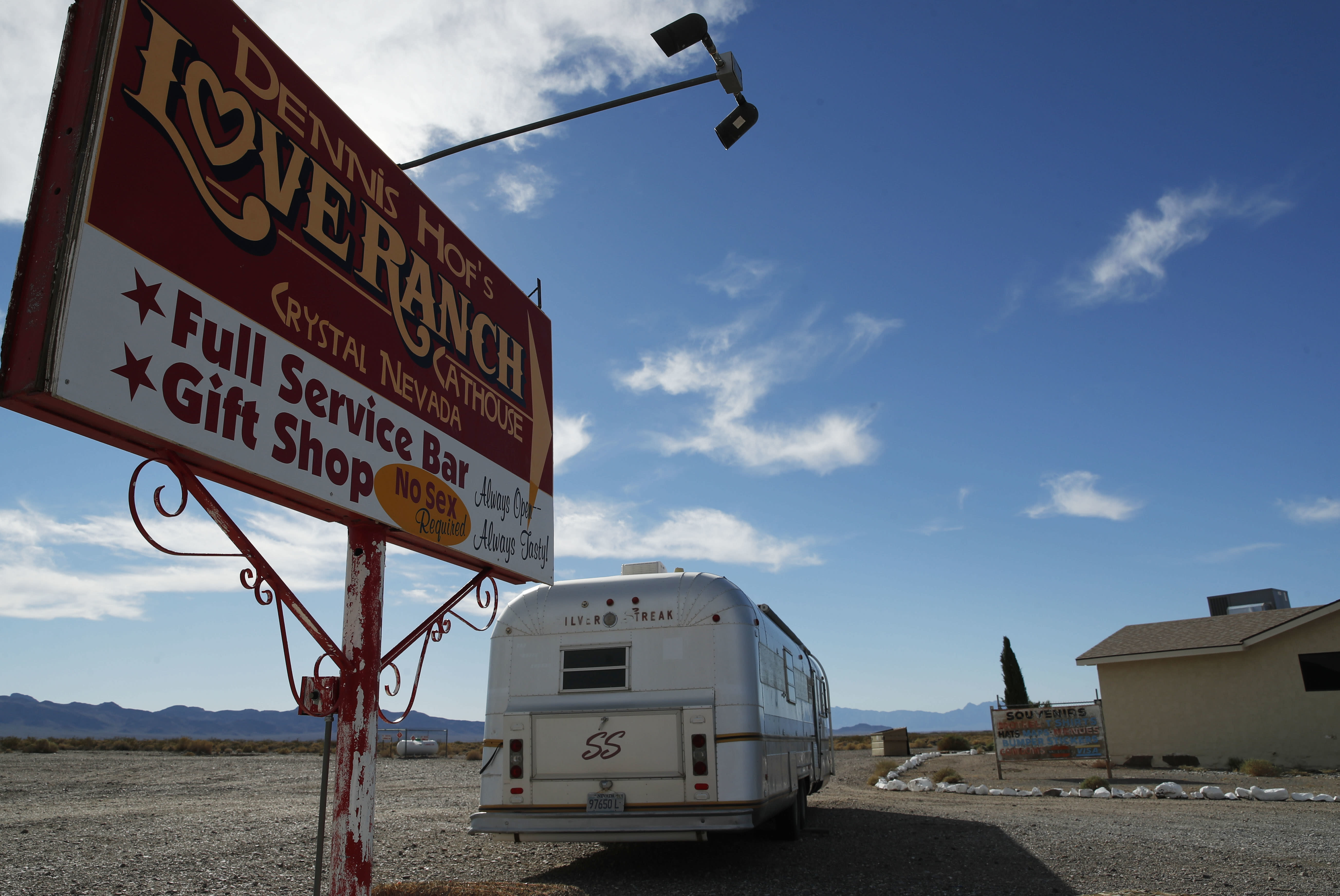 File - In this Oct. 16, 2018, file photo, a sign advertises the Love Ranch brothel in Pahrump, Nev. A federal judge in Nevada has dismissed a lawsuit that invoked sex trafficking laws in a bid to close the nation's only legal brothels. U.S. District Judge Miranda Du in Reno cited jurisdictional grounds, after saying in her Tuesday, Oct. 29, 2019, ruling that she empathizes with the three women who claim they were sexual violence victims in Nevada and other states. The women live in Texas, and the judge says she's not convinced the profound harm they say they suffered was due to Nevada prostitution laws. (AP Photo/John Locher, File)