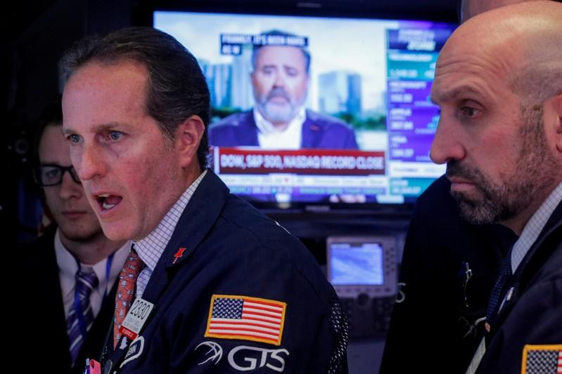 Dollar, stocks slide on Trump tweets, dour PMI data