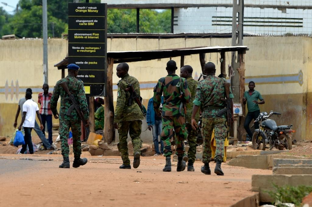 Soldiers, paramilitary gendarmes and police are on patrol to prevent any flare-up of violence (AFP Photo/SIA KAMBOU)