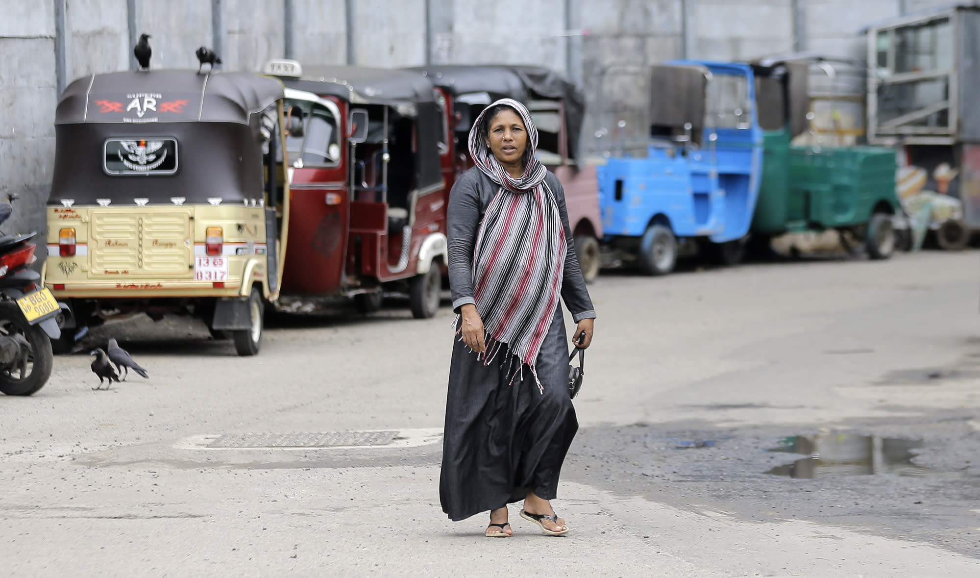 A Sri Lankan Muslim woman walks in a street in Colombo, Sri Lanka, Tuesday, Aug. 27, 2019. Islamic clerics in Sri Lanka asked Muslim women on Tuesday to continue to avoid wearing face veils until the government clarifies whether they are once again allowed now that emergency rule has ended four months after a string of suicide bomb attacks. (AP Photo/Eranga Jayawardena)