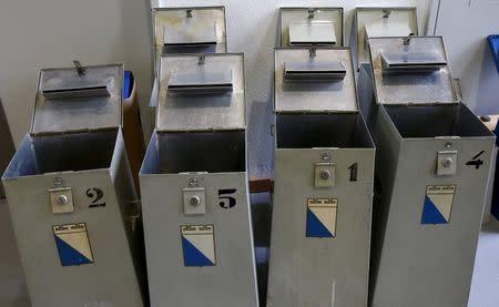 Empty ballot boxes stand at an election office in Zurich, Switzerland, October 18, 2015. REUTERS/Arnd Wiegmann