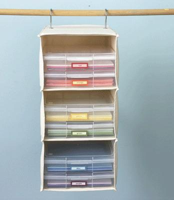 """<p>A handy hanging cloth storage bin isn't just for sweaters. It can neatly stash nearly anything (including the construction paper show here). (Credit: <a href=""""http://www.apartmenttherapy.com/repurposed-upcycled-and-diy-st-108206"""" rel=""""nofollow noopener"""" target=""""_blank"""" data-ylk=""""slk:Apartment Therapy"""" class=""""link rapid-noclick-resp"""">Apartment Therapy</a>)</p>"""