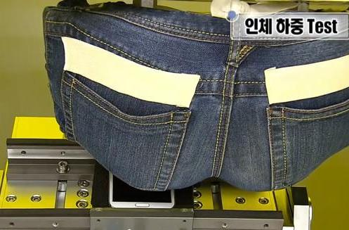 Beaten, twisted, sprayed and sat on: how Samsung stress tests its phones (video)