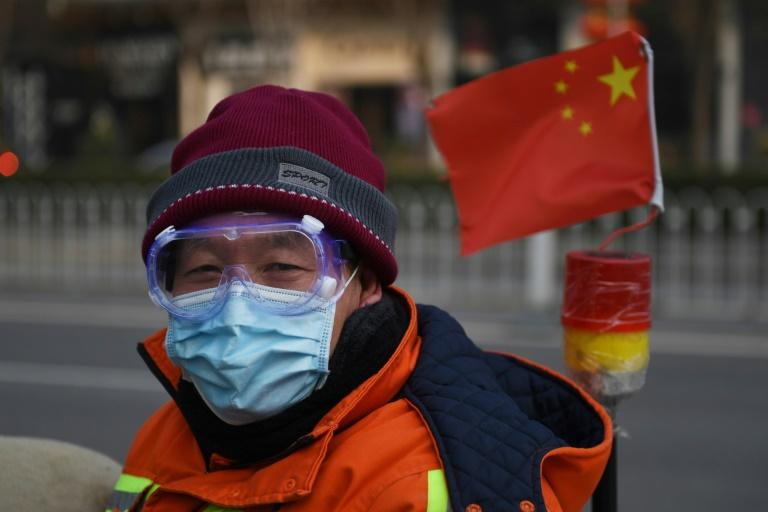 The virus has infected thousands in China and spread to dozens of other countries (AFP Photo/GREG BAKER)