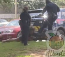 Atlanta police identify officers who were suspended after video appeared to show one of them kicking handcuffed woman in the head