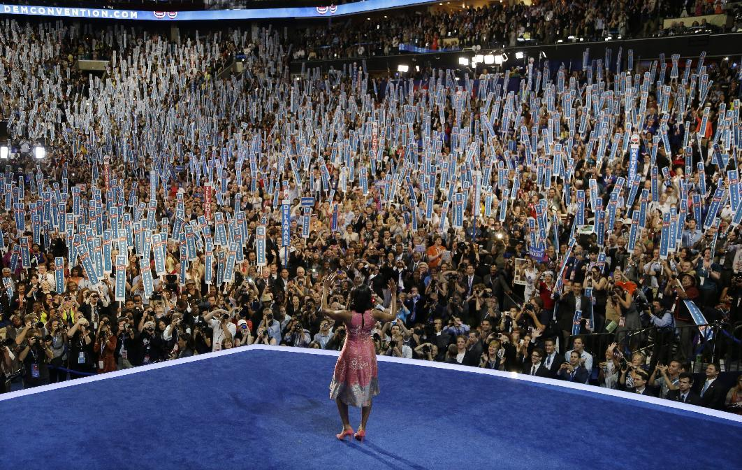 First Lady Michelle Obama walks on stage to speak to the Democratic National Convention in Charlotte, N.C., on Tuesday, Sept. 4, 2012. (AP Photo/Charlie Neibergall)