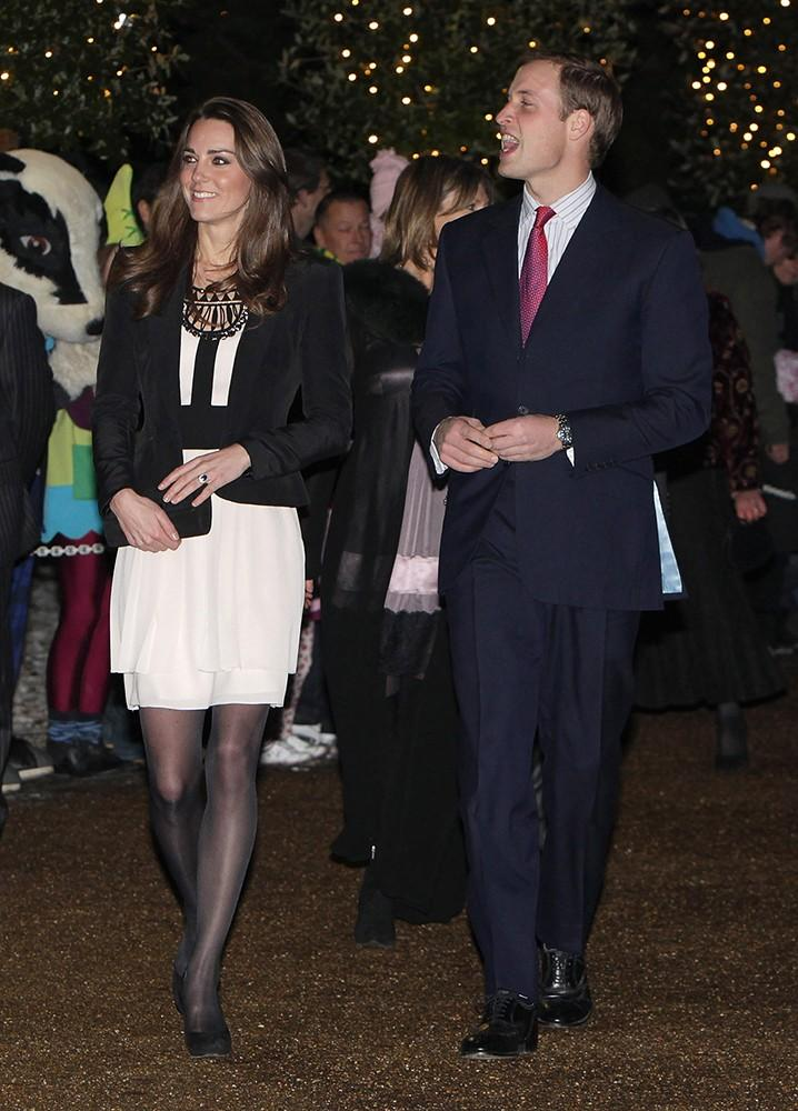 """The couple attended a Christmas """"Spectacular,"""" Kate dressed in contrasting black and white with a bold necklace."""