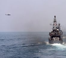 U.S. Navy Fires Warning Shots Near an Iranian Ship in the Persian Gulf