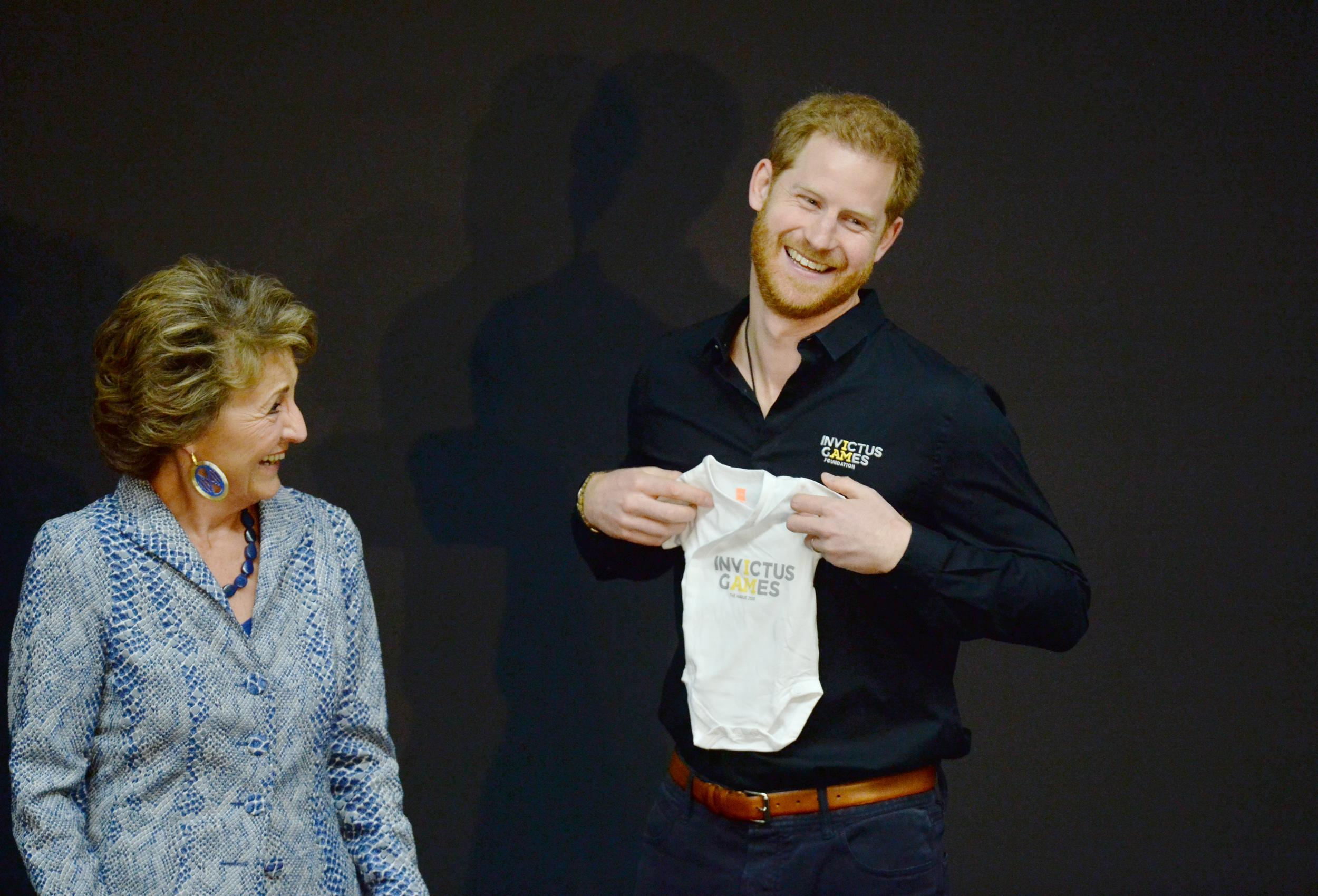 The Duke of Sussex receives a gift for his new son, Archie, from Princess Margriet of the Netherlands at a sports training session at Sportcampus Zuiderpark during a visit to The Hague as part of a programme of events to mark the official launch of the Invictus Games, Netherlands. (Photo by Kirsty O'Connor/PA Images via Getty Images)