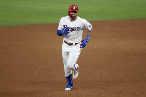 Texas Rangers' Joey Gallo rounds the bases after hitting a two-run home run off a pitch from Los Angeles Angels starter Patrick Sandoval in the sixth inning of a baseball game in Arlington, Texas, Saturday, Aug. 8, 2020. (AP Photo/Tony Gutierrez)