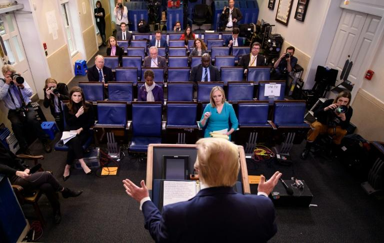 US President Donald Trump's daily briefing is a hit on live television (AFP Photo/MANDEL NGAN)