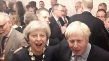 Past rivals Theresa May and Boris Johnson pictured celebrating Tory win