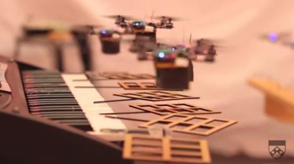 Mini quadrotors play Bond, James Bond (video)