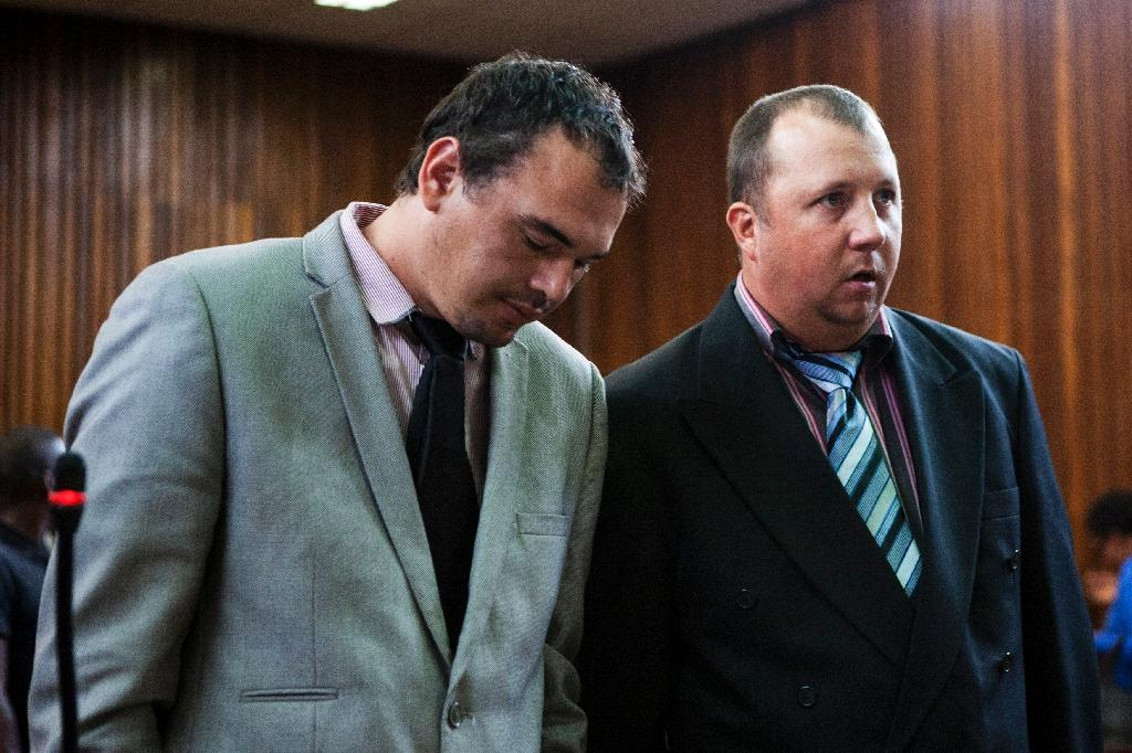 Willem Oosthuizen, left, and Theo Jackson filmed themselves forcing a black man into a coffin and threatening to burn him alive (AFP Photo/WIKUS DE WET)