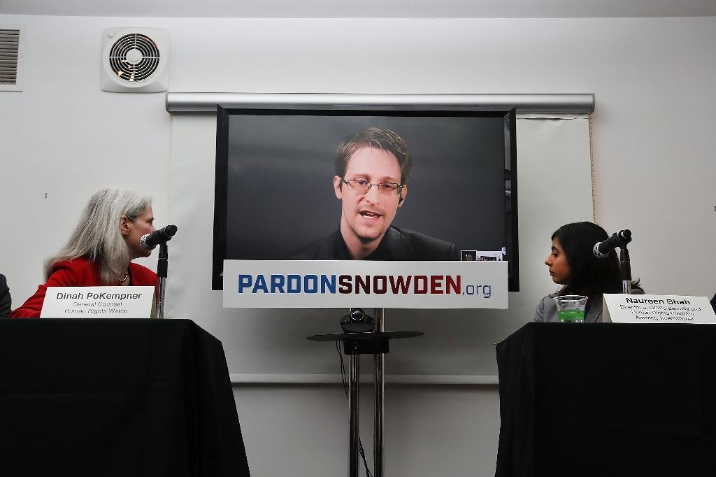 Fugitive whistleblower Edward Snowden hit back at the Hong Kong government for rejecting the protection bids of a group of refugees who sheltered him while he was hiding out in the city (AFP Photo/SPENCER PLATT)