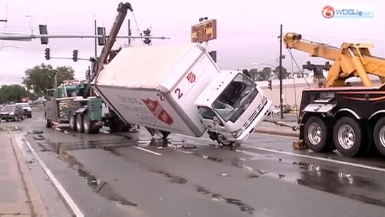 Crews work to upright truck in Metairie during tornado aftermath