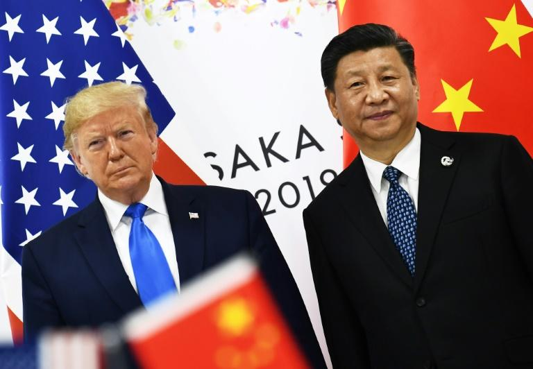 US President Donald Trump (left) and his Chinese counterpart Xi Jinping ordered fresh increases on hundreds of billions of dollars in two-way trade in August 2019 (AFP Photo/Brendan Smialowski)