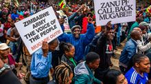 Thousands march in Zimbabwe against President Robert Mugabe after military put longtime ruler under house arrest