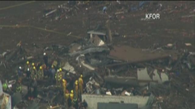 Tulsa firefighters join search and rescue efforts in Moore after massive tornado