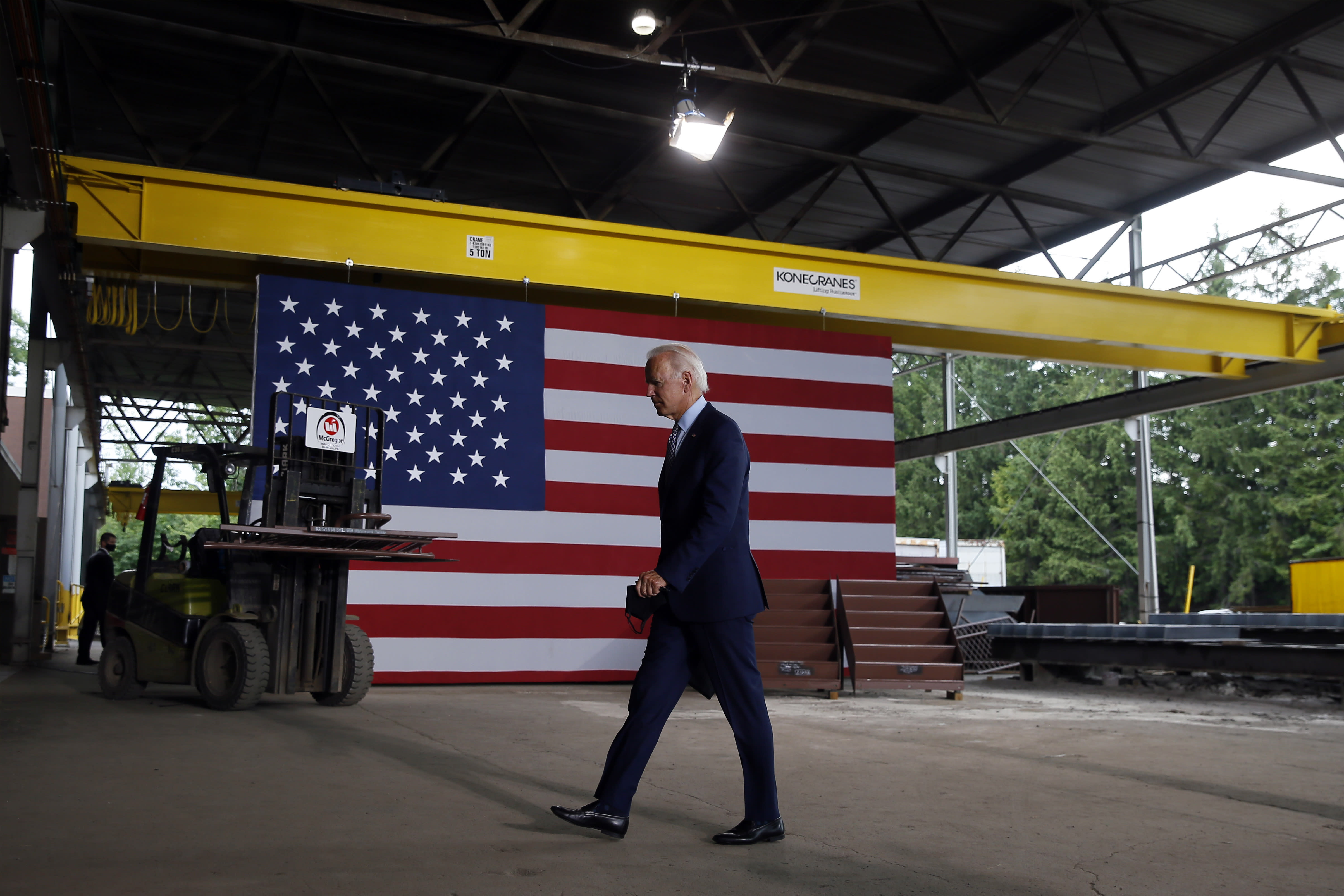 FILE - In this July 9, 2020, file photo Democratic presidential candidate former Vice President Joe Biden walks from the podium after speaking at McGregor Industries in Dunmore, Pa. Biden is pledging to define his presidency by a sweeping economic agenda beyond anything Americans have seen since the Great Depression and the industrial mobilization for World War II. (AP Photo/Matt Slocum, File)