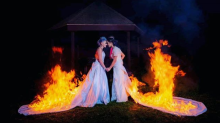 Daredevil brides light their wedding dresses on fire during ceremony