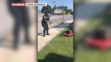 Video of police officer mowing woman's lawn goes viral: 'She was raised right'