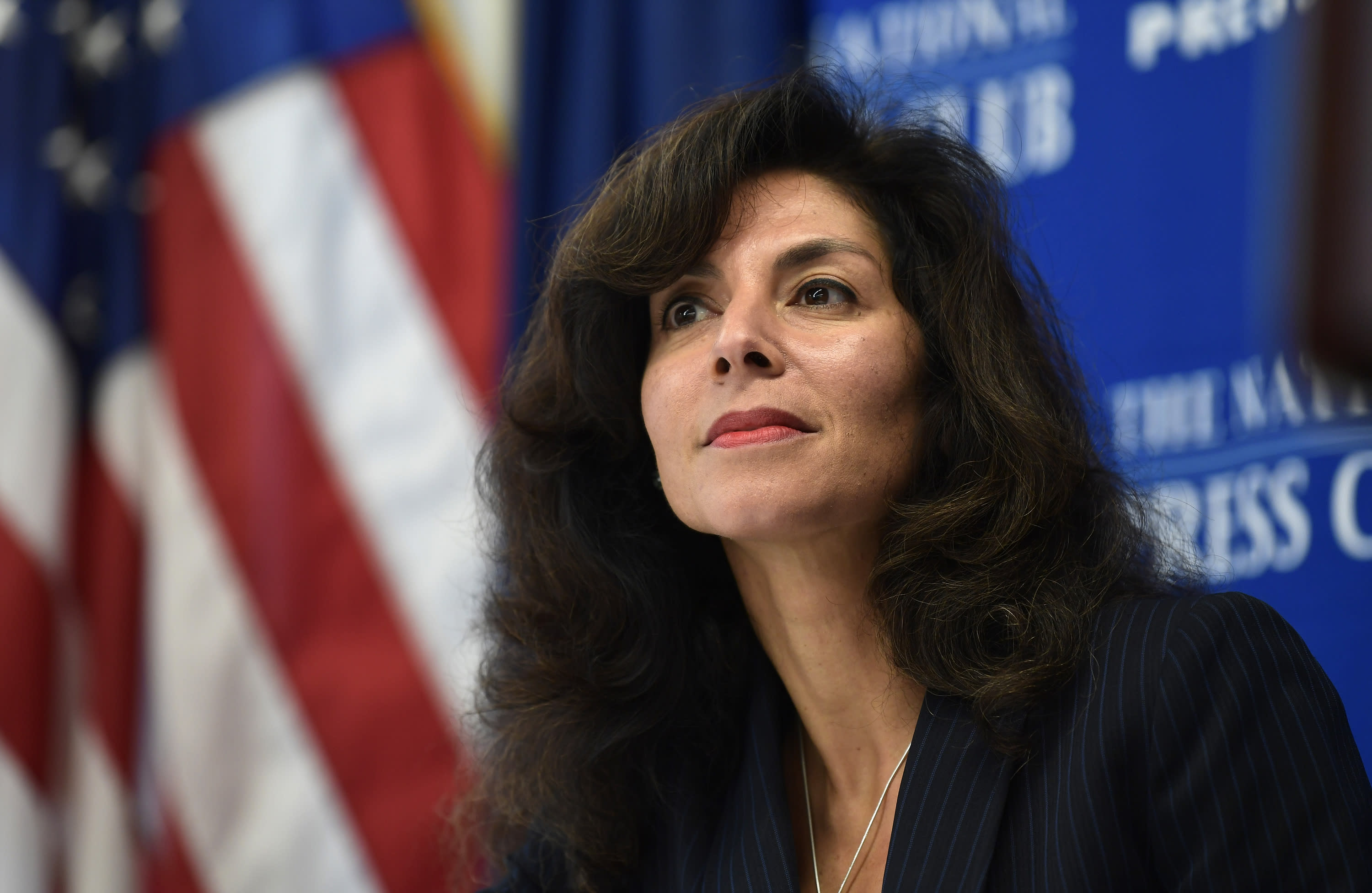 FILE - In this Sept. 21, 2018, file photo, A. Ashley Tabaddor, a federal immigration judge in Los Angeles who serves as the President of the National Association of Immigration Judges, listens as she is introduced to speak at the National Press Club in Washington, on the pressures on judges and the federal immigration court system. Immigration judges say they are being muzzled by the Trump administration and the union that represents them is suing the U.S. Department of Justice. The lawsuit filed Wednesday, July 1, 2020, is the latest confrontation between the judges and the Justice Department, which oversees U.S. immigration courts. (AP Photo/Susan Walsh, File)