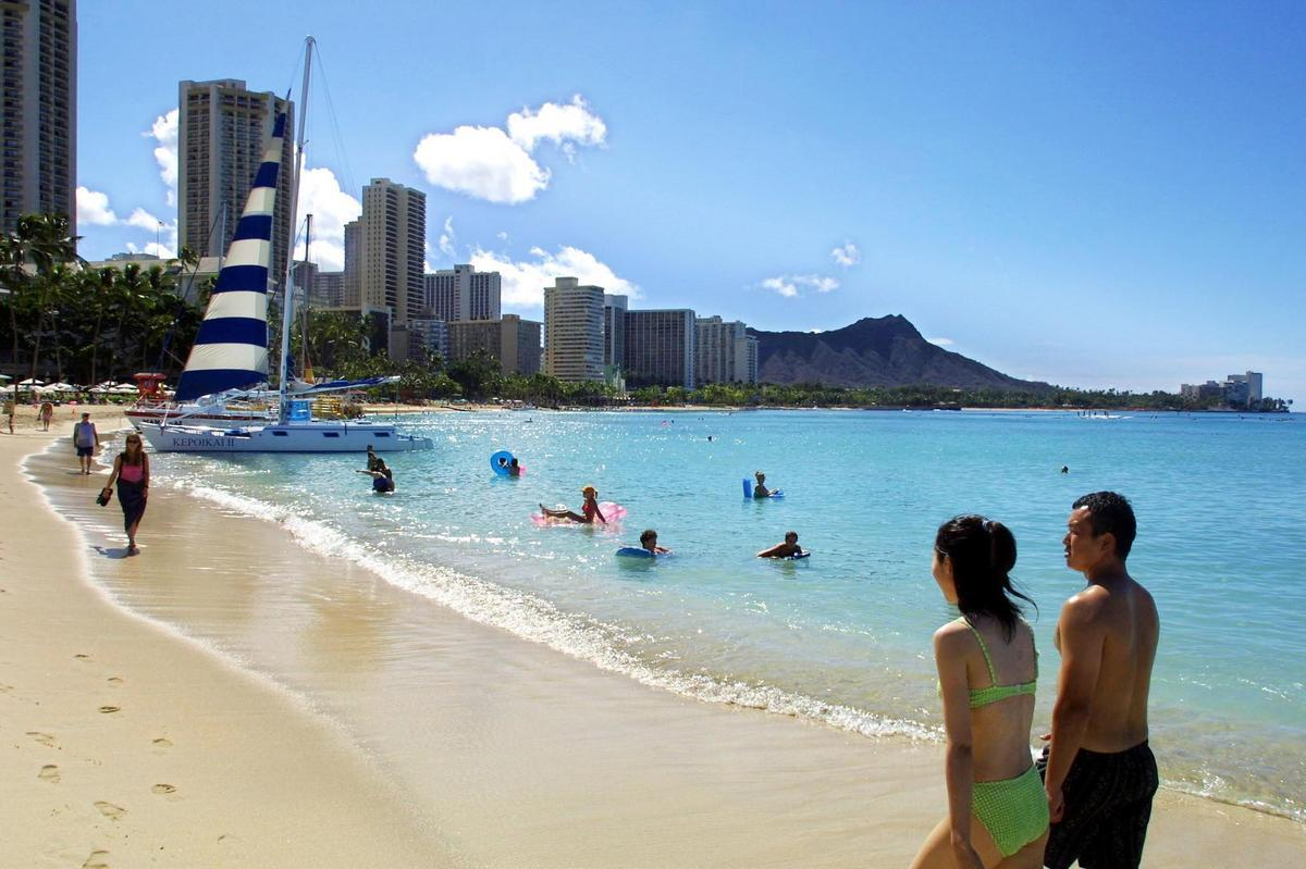 """<p>Hawaii</p>  <p>After 14 unprovoked shark attacks were reported in Hawaii in 2013, according to <a href=""""http://www.hawaiisharks.com/index.html"""">hawaiisharks.com</a>, locals have become increasingly nervous about the risk posed by sharks</p>  <p>From 1828 to December 2013 there have been 128 total unprovoked shark attacks in Hawaii, 10 of which were fatal attacks, according to the International Shark Attack File at the Florida Museum of Natural History.</p>  <p>Picture: Japanese tourists stroll along Waikiki Beach in Hawaii, following a shark siting in 2001, which closed the beach.</p>"""