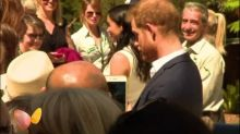Live pictures show Harry and Meghan greet staff at Taronga Zoo