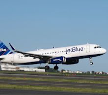 JetBlue is laying off workers and reshuffling jobs as it moves to cut $300 million in costs (JBLU)
