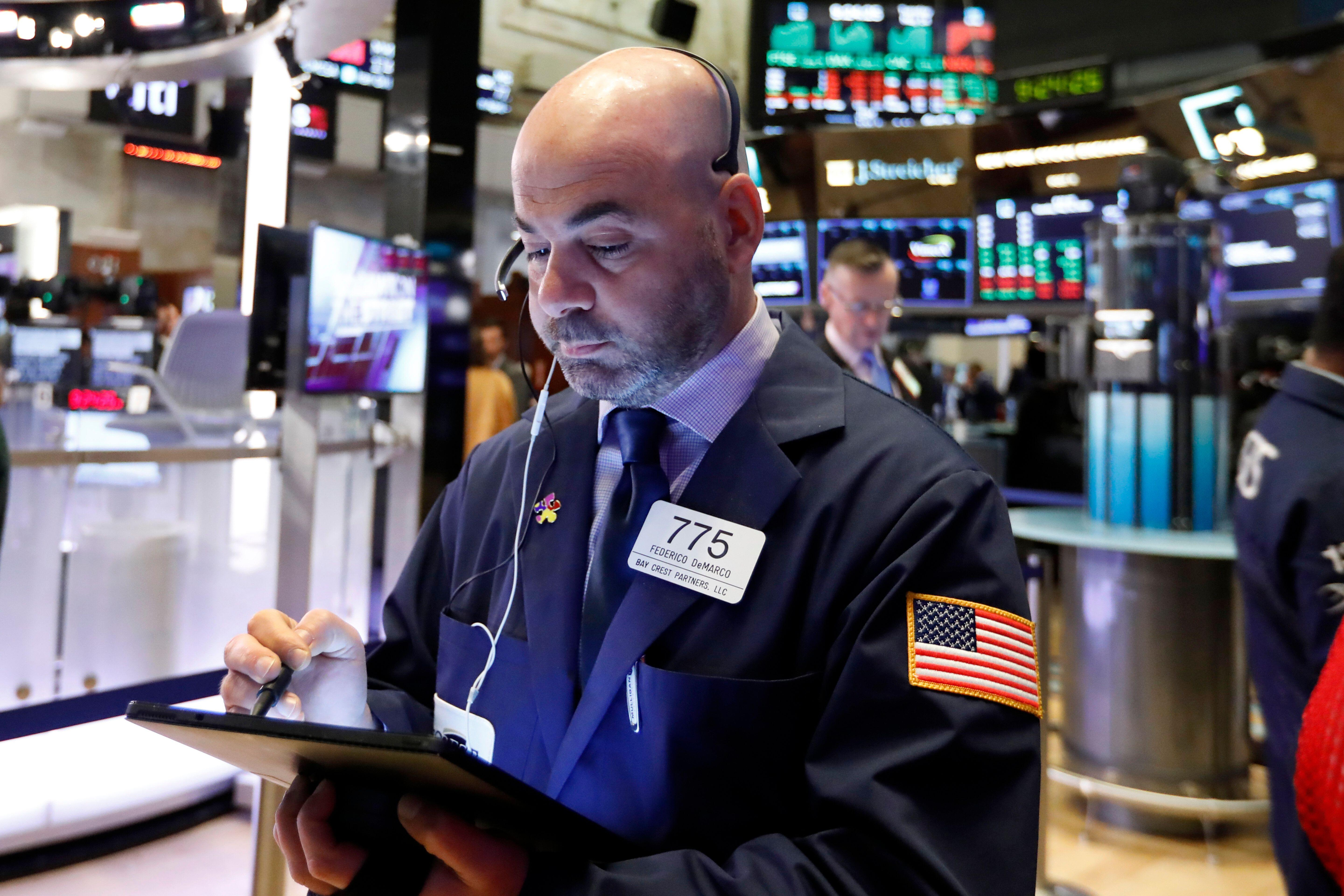 Stocks end lower as trade woes whipsaw markets