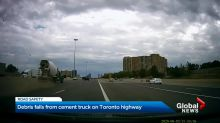 Debris falls from cement truck on Toronto highway