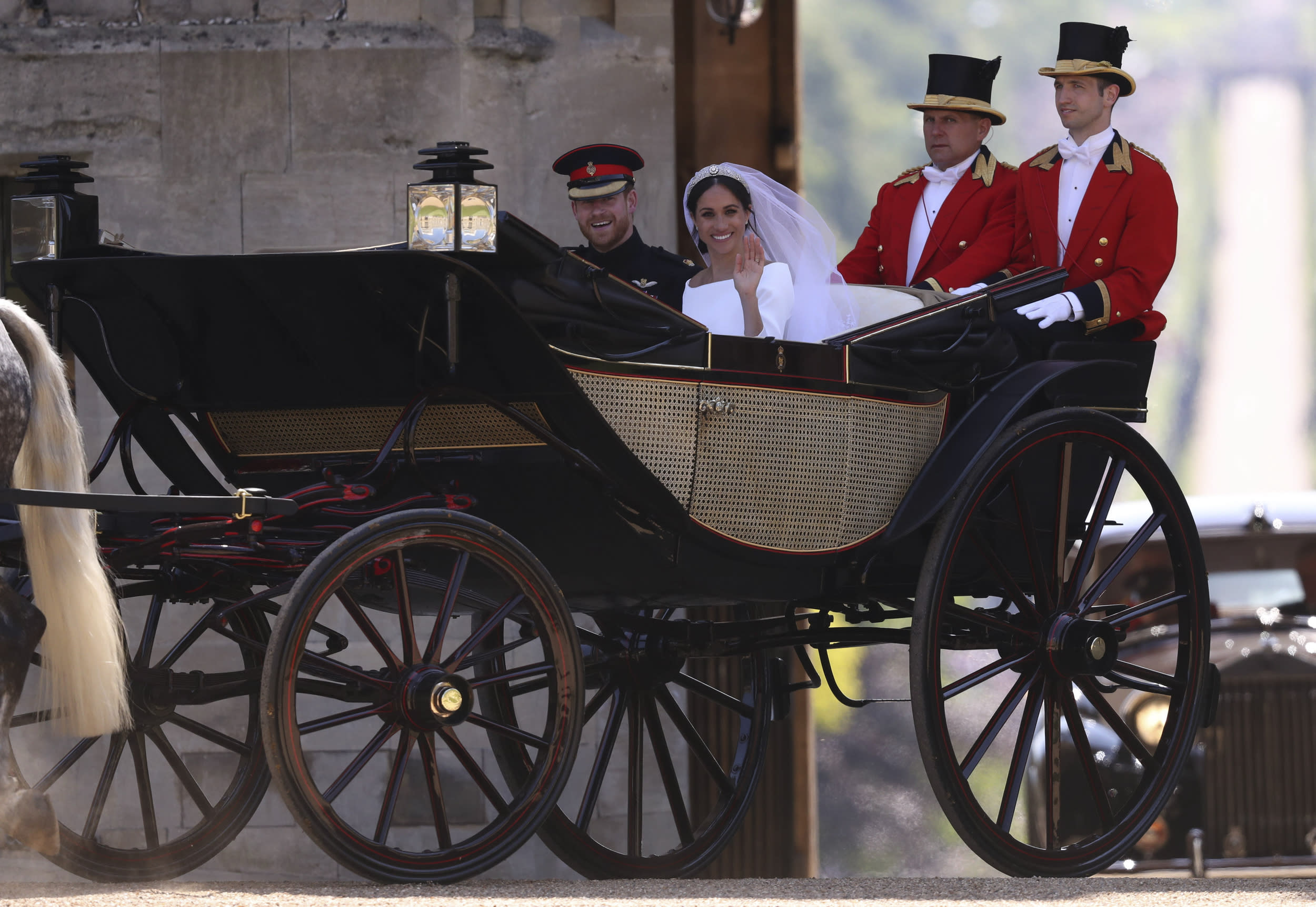 <p>Britain's Prince Harry, Duke of Sussex and his wife Meghan, Duchess of Sussex arrive back at Windsor Castle in the Ascot Landau Carriage after their wedding ceremony and after their procession in Windsor, on May 19, 2018.</p>  <p>(Photo by Steve Parsons / POOL / AFP)</p>