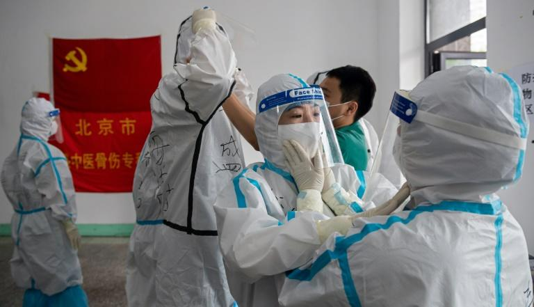 China has recorded 61 new coronavirus cases -- the highest daily figure since April -- propelled by clusters in three separate regions