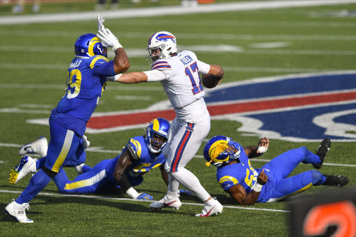 Los Angeles Rams' Aaron Donald, left, rushes Buffalo Bills quarterback Josh Allen during the second half of an NFL football game Sunday, Aug. 26, 2018, in Orchard Park, N.Y. Allen was called for a face mask penalty on the play. The Bills won 35-32. (AP Photo/Adrian Kraus)