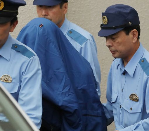 Japan knife attacker grins before cameras after killing spree