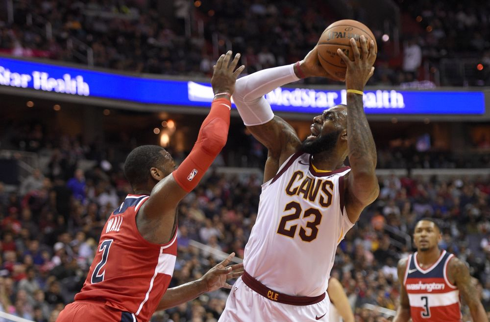 Washington Wizards guard John Wall (2) defends Cleveland Cavaliers forward LeBron James (23) during the first half of an NBA basketball game, Friday, Nov. 3, 2017, in Washington. (AP Photo/Nick Wass)