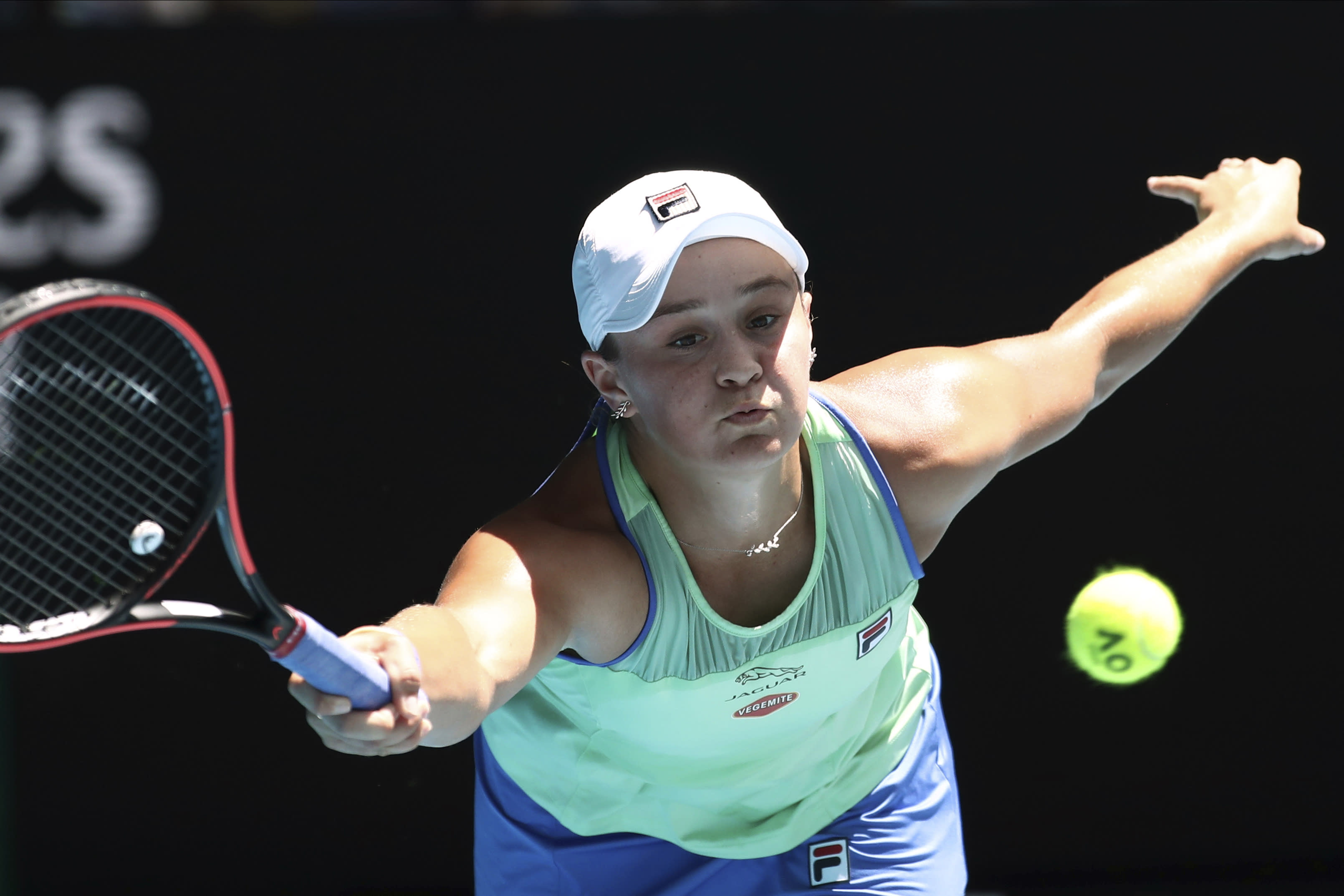 FILE - In this Jan. 28, 2020, file photo, Australia's Ash Barty makes a forehand return to Petra Kvitova of the Czech Republic during their quarterfinal match at the Australian Open tennis championship in Melbourne, Australia. Top-ranked Ash Barty has withdrawn from the U.S. Open because she is not comfortable with traveling during the coronavirus pandemic. (AP Photo/Dita Alangkara, File)