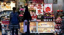 Japan government reiterates its view the economy is recovering 'gradually'