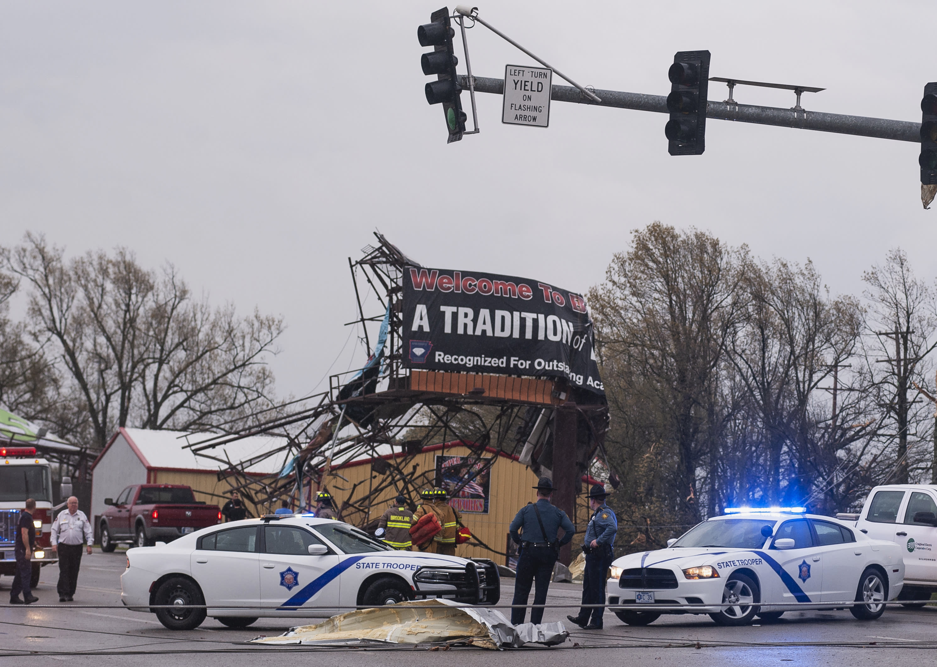 Arkansas State Police and other first responders survey the damage in Jonesboro, Ark., Saturday, March 28, 2020, after a tornado touched down in the area. Officials in Arkansas say a tornado ripped through northeast Arkansas and hurt some people in the college town of Jonesboro. (Quentin Winstine/The Jonesboro Sun via AP)