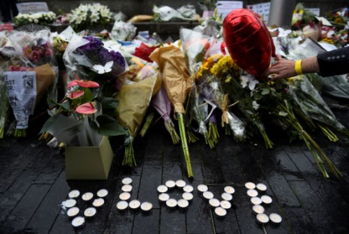A person lays a floral tribute near the scene of the London Bridge attack