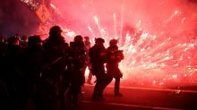Police use tear gas, Portland protesters throw fire bombs