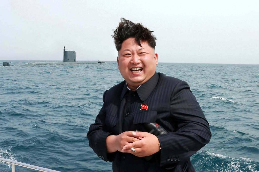 North Korean leader Kim Jong-Un smiles while observing an underwater test-fire of a submarine-launched ballistic missile at an undisclosed location at sea in this official state media image from May 9, 2015 (AFP Photo/)