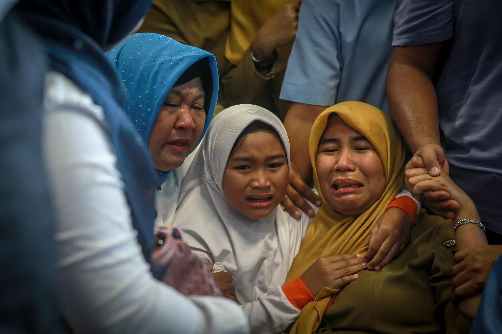 The Boeing-737 MAX 8, which went into service just a few months ago, crashed into the Java Sea off Indonesia's northern coast moments after it had asked to return to Jakarta on Monday (AFP Photo/HADI SUTRISNO)