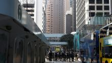Police shooting rattles Hong Kong markets, investors count on Alibaba listing