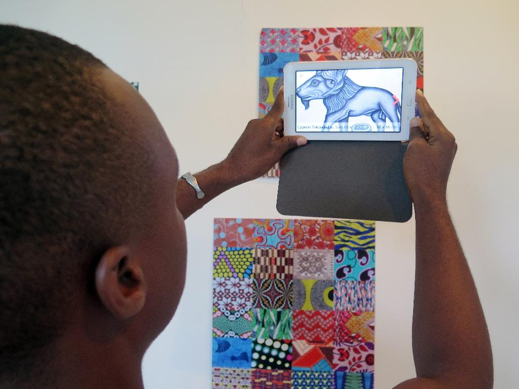 A new smartphone application developed by a foundation based in Cotonou, the largest city in Benin, is seeking to bring art to the masses (AFP Photo/Delphine Bousquet)