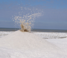 'Ice volcanoes' erupt on a Lake Michigan beach. Here's what they look like.