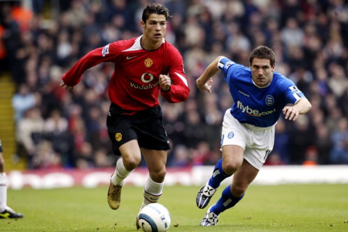 Birmingham City's David Dunn (r) and Manchester United's Cristiano Ronaldo (l) battle for the ball