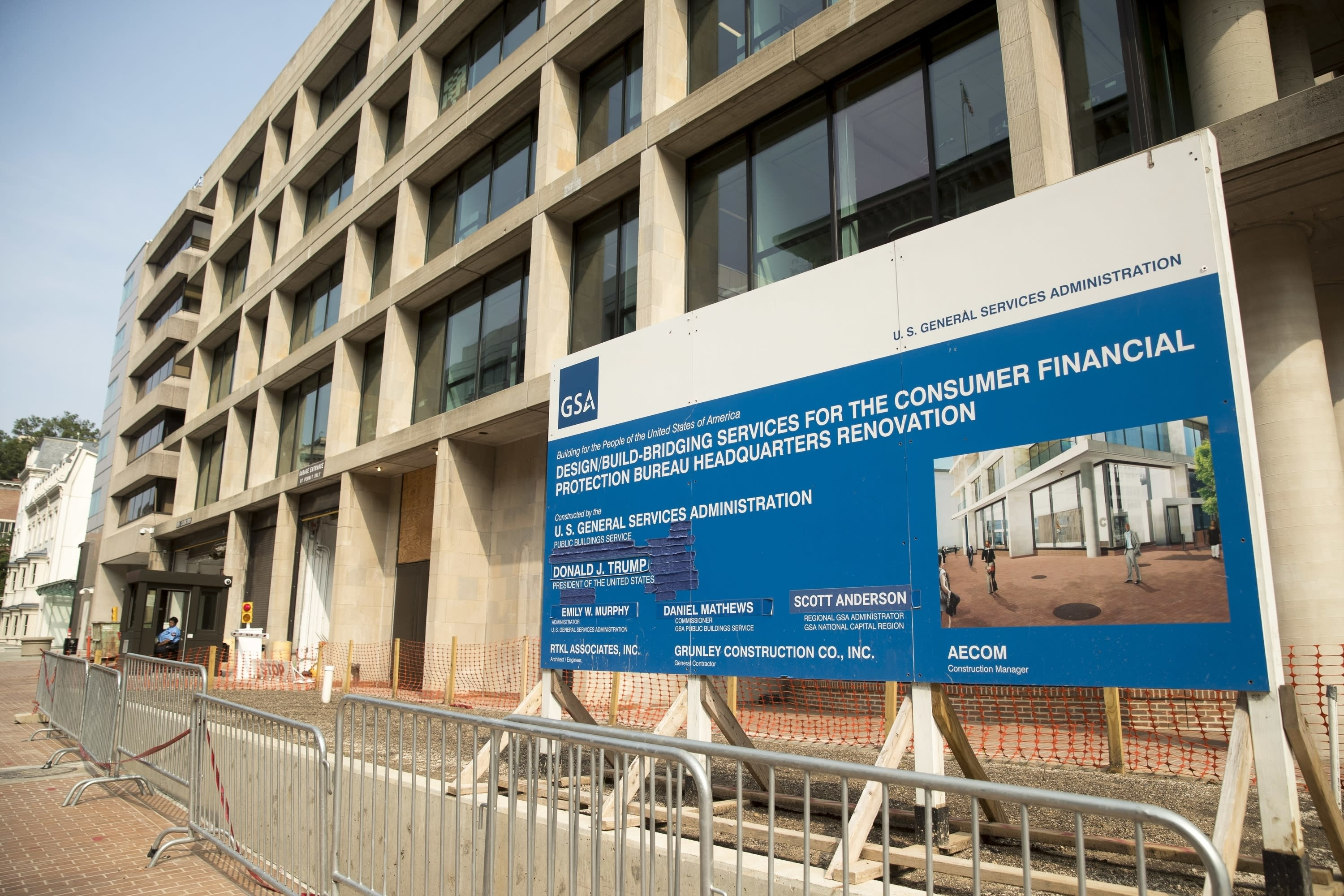 FILE - In this Aug. 27, 2018, file photo, a patched sign stands at the construction site for the Consumer Financial Protection Bureau's new headquarters in Washington. California created what supporters called its own nation-leading, state-level version of the federal Consumer Financial Protection Bureau after critics said the Trump administration significantly weakened national protections, Friday, Sept. 25, 2020. The legislation that Gov. Gavin Newsom signed into law changes the existing Department of Business Oversight into the Department of Financial Protection and Innovation in what proponents said is the first such move by any state. (AP Photo/Andrew Harnik, File)