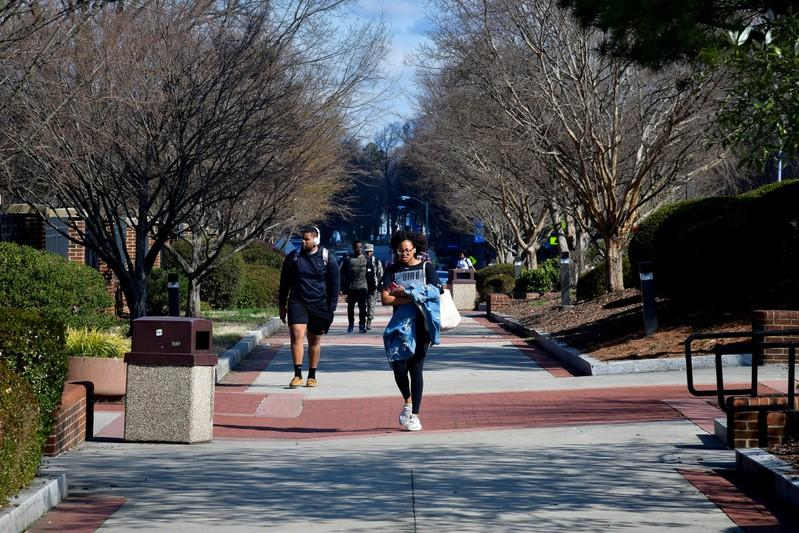 FILE PHOTO: Students walk between classes at North Carolina A&T University along the line that divides Congressional Districts 13 and 6 on campus in Greensboro